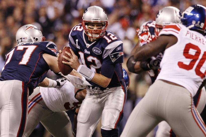 New England Patriots quarterback Tom Brady scrambles against the New York Giants during the second quarter in the NFL Super Bowl XLVI football game in Indianapolis, Indiana