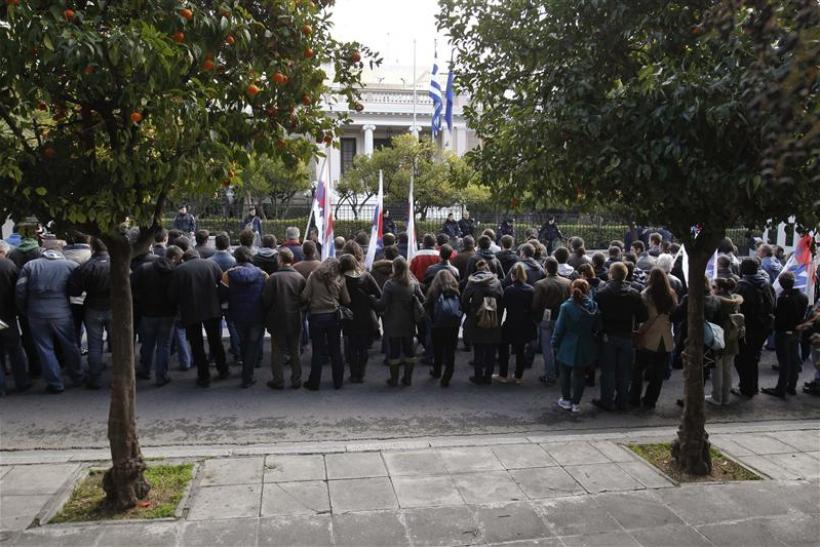 Demonstrators from the communist-affiliated trade union PAME protest outside the Greek Prime Minister's office in Athens
