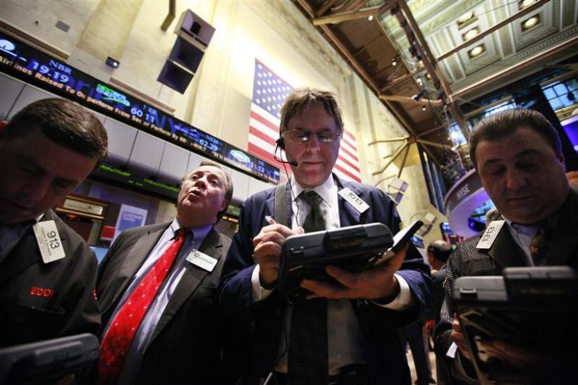 Traders gather at a post on the floor of the New York Stock Exchange