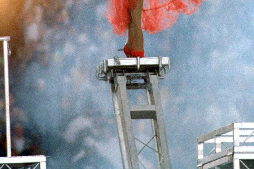 Diana Ross makes her entrance on a raised platform during the elaborate Super Bowl XXX halftime show