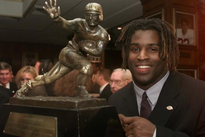 Texas running back Ricky Williams shows off the 1998 Heisman trophy after being named the top collegiate football player