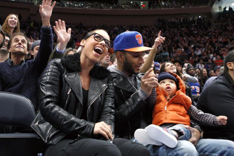 One happy family, Alicia Keys sits with husband Swizz Beatz and their son during the Knicks and Celtics basketball game in New York