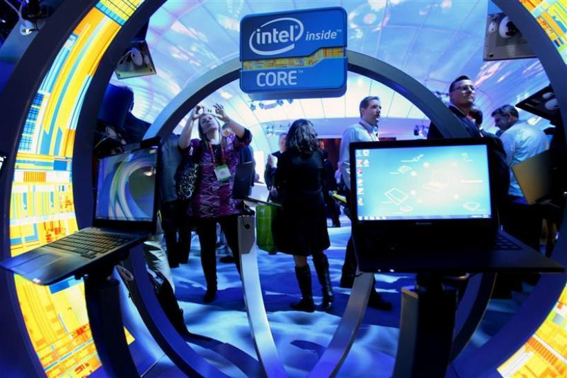 A woman takes a photo of ultrabooks at the Intel booth during the 2012 International Consumer Electronics Show in Las Vegas