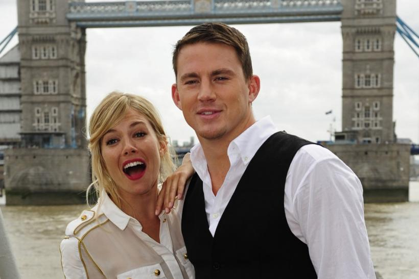 British actress Sienna Miller and U.S. actor Channing Tatum pose for photographers during a photocall to promote their new film 'G.I. Joe', in front of Tower Bridge, on HMS Belfast on the River Thames in London