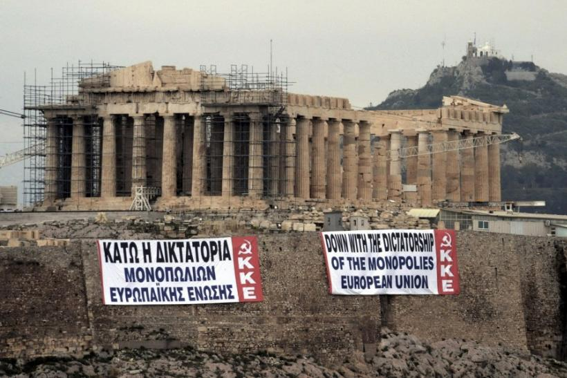 Two anti-austerity banners, placed by activists of the Greek Communist party, are displayed on a hill at the Acropolis in Athens February 11, 2012.