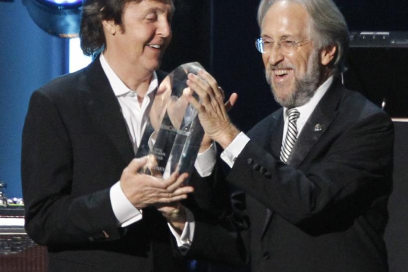 President of the National Academy of Recording Arts and Sciences Neil Portnow (R) presents British musician Paul McCartney with the 2012 MusiCares Person of the Year award in Los Angeles, California