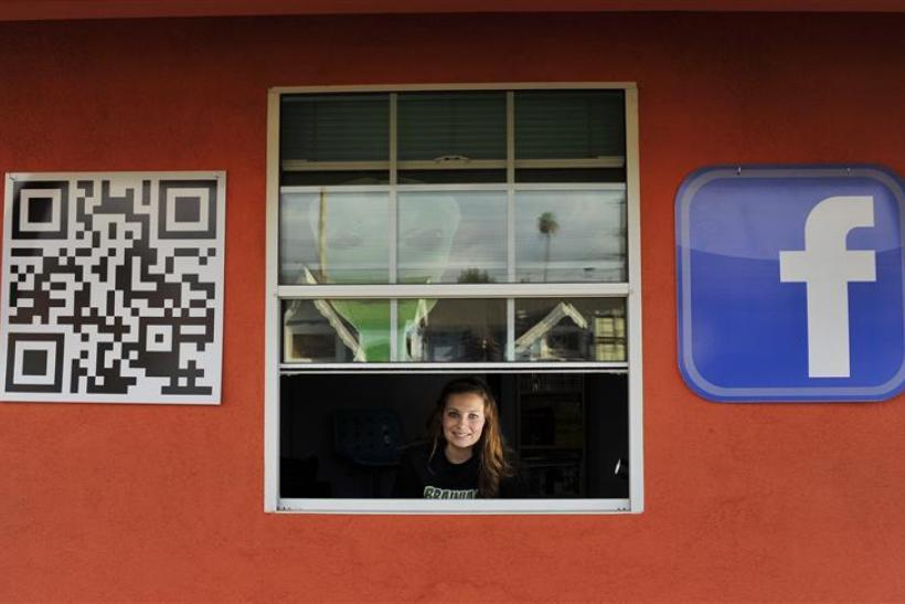 Sarah Hostetler looks out from her home in Buena Park, California