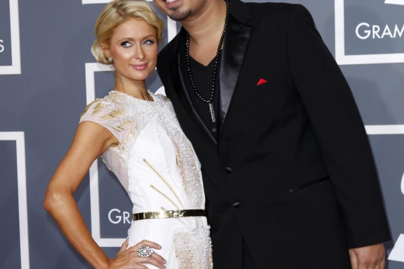Paris Hilton and producer Afrojack arrive at the 54th annual Grammy Awards in Los Angeles, California