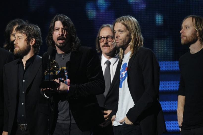 The band Foo Fighters accept the award for best rock performance at the 54th annual Grammy Awards in Los Angeles, California