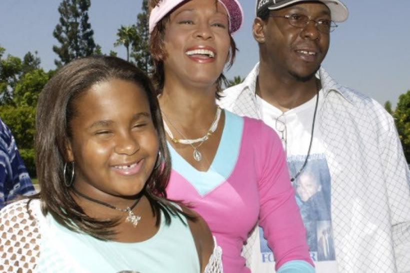 Singer Whitney Houston, Bobby Brown and daughter Bobbi Kristina Brown