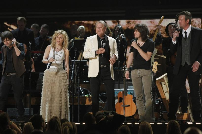 Singer Glen Campbell (C) takes the stage with the members of The Band Perry and Blake Shelton (R) during a tribute to Campbell at the 54th annual Grammy Awards in Los Angeles, California