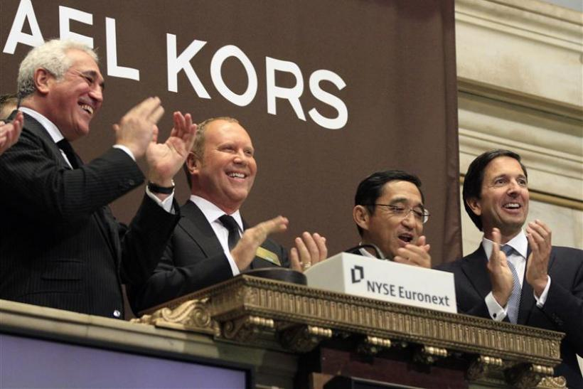 Designer Michael Kors celebrates after ringing the opening bell with guests of Michael Kors Holdings Ltd. at the New York Stock Exchange