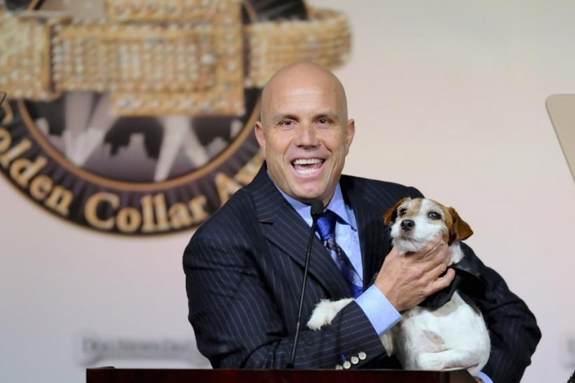 "Dog owner-trainer Omar Von Muller excepts award for his dog Uggie who won ""Best Dog in A Theatrical Film"" for its role in the ""The Artist"" during the first annual Golden Collar Awards celebrating Hollywood's most talented canine thespi"