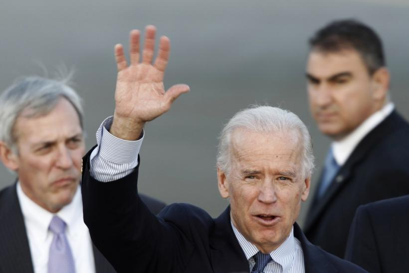 U.S. Vice President Joe Biden waves during his arrival at the Athens Eleftherios Venizelos airport in Athens