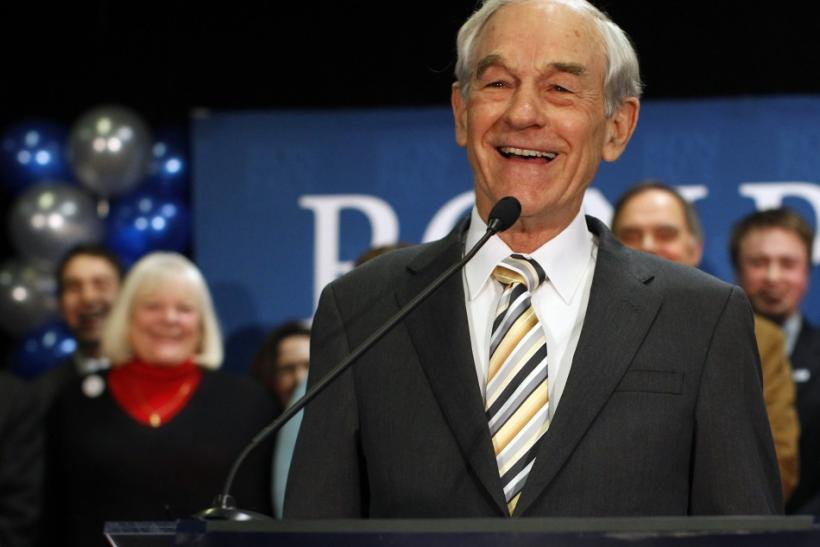 Republican presidential candidate Ron Paul smiles while speaking to supporters at his Maine caucus night rally in Portland