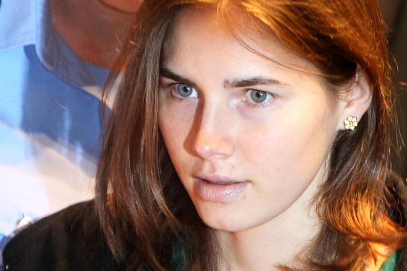 Amanda Knox--shown here arriving in court for her appeal trial session in Perugia, Italy, in October last year--signed a book deal with HarperCollins today