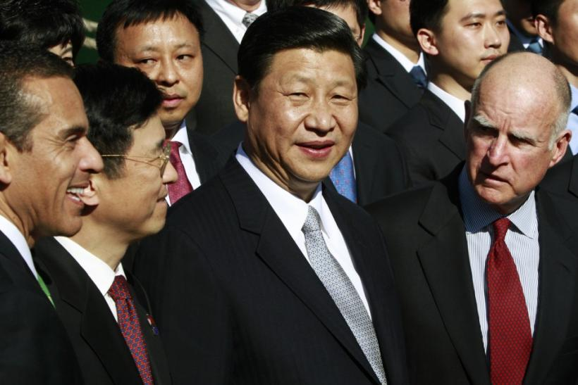 Los Angeles Mayor Villaraigosa, China Shipping Chairman Shaode, Chinese Vice President Jinping and California Governor Brown talk during a visit to the Port of Los Angeles in San Pedro