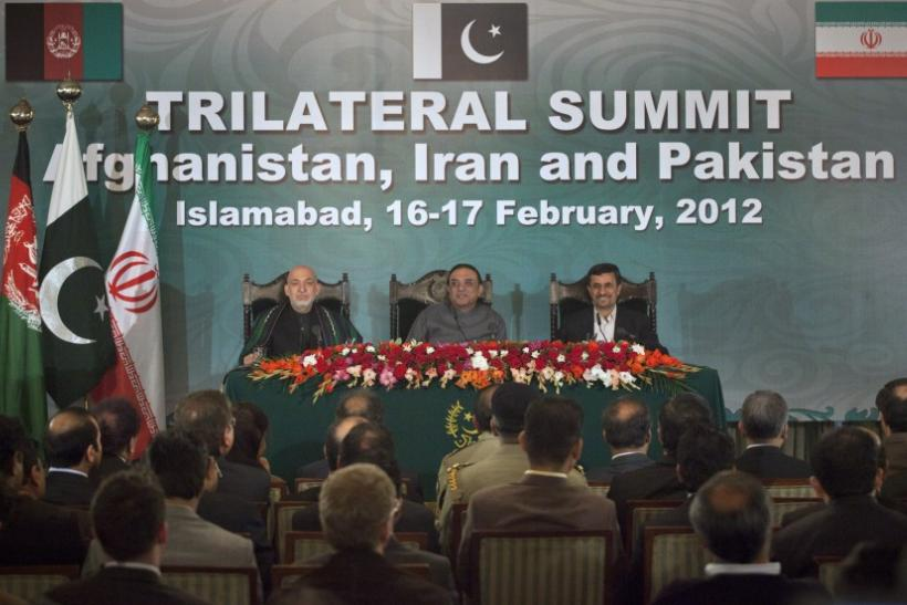 Afghanistan's President Hamid Karzai (L), Pakistan's President Asif Ali Zardari (C) and Iran's President Mahmoud Ahmadinejad listen to a question during joint news conference in the President House in Islamabad on February 17, 2012.