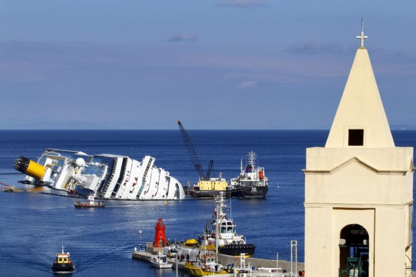 Oil tanker Elba, right, and oil recovery sea platform Meloria, center, are seen on Feb. 15 during the extraction of fuel from the shipwrecked luxury liner Costa Concordia