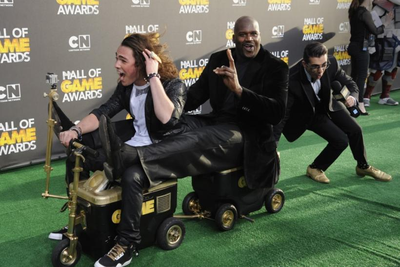 Host Shaquille O'Neal (C) takes a ride with Jackson Rogow (L) as he arrives at the Cartoon Network's Hall of Game Awards