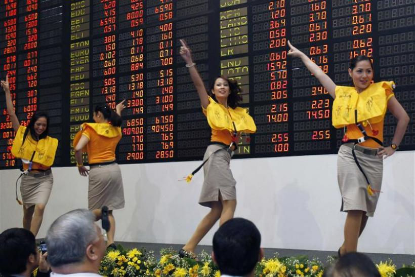 To match Insight PHILIPPINES/Cebu Pacific airlines cabin crew perform a safety demonstration routine during a ceremony inside a trading floor of the stock exchange in Makati's financial district of Manila in this October 26, 2010 file photo.