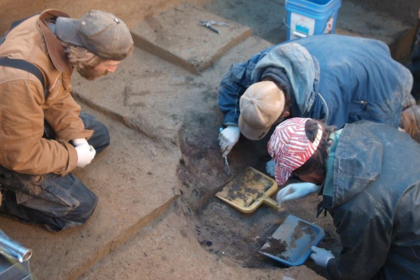Members of the excavation team Joshua Reuther, Ben Potter and Joel Irish excavate the burial pit at the Upward Sun River site in central Alaska