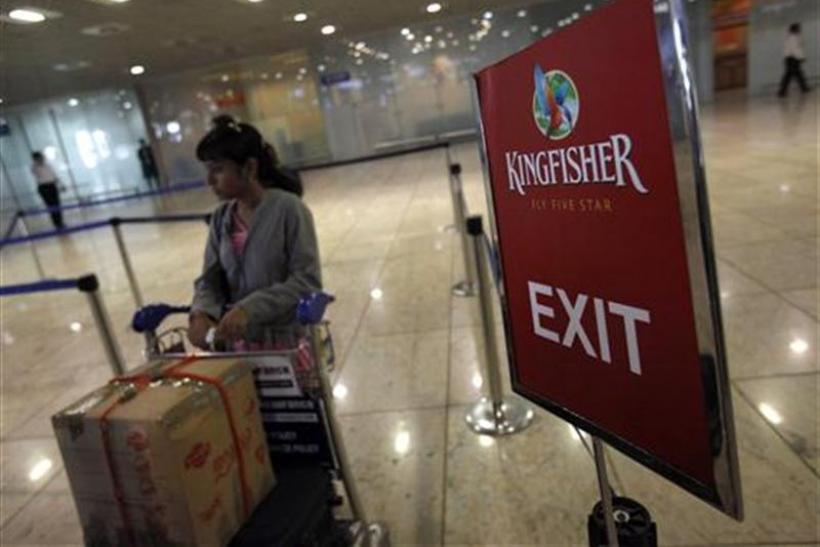 A lone Kingfisher Airlines customer waits in a check-in queue at Mumbai's domestic airport