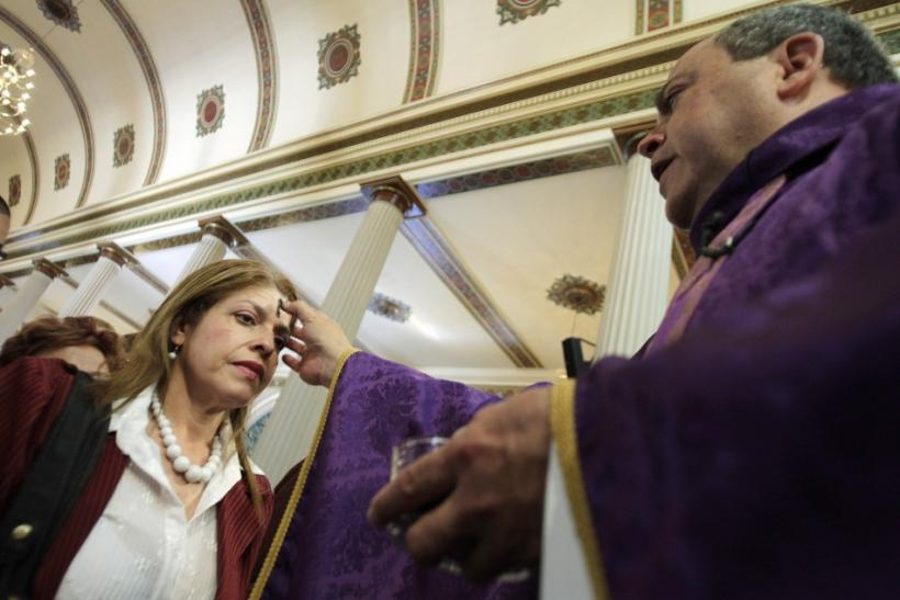 A woman receives ashes during the traditional Ash Wednesday service, at the Metropolitan Cathedral in San Jose.