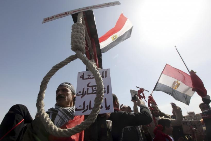Relatives of victims killed during the revolution demonstrate outside the court house calling for Mubarak's execution