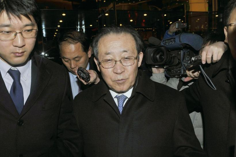 North Korea's First Vice Foreign Minister and envoy to the six-party talks Kim Kye-gwan enters a hotel in Beijing
