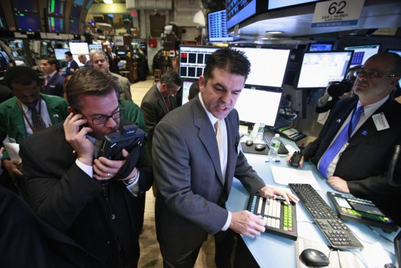 Specialist David Haubner (C) gives prices for the IPO of Proto Labs on the floor of the New York Stock Exchange February 24, 2012.