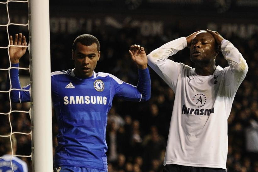 Chelsea's Ashley Cole, shown here with Tottenham's William Gallas, could be tempted by a summer switch to Barcelona