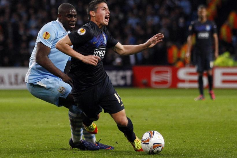 Porto's James Rodriguez, a reported target for Manchester United, is challenged by Manchester City's Micah Richards during the sides' Europa League meeting at the Etihad Stadium