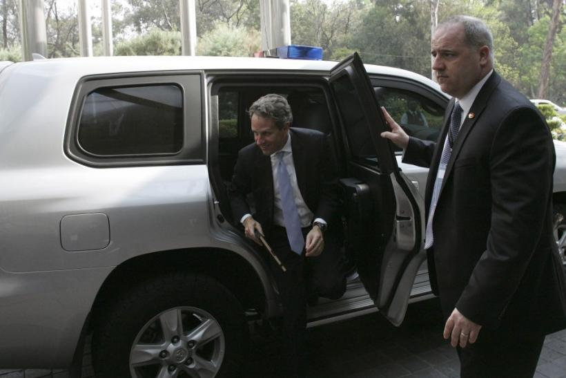 U.S. Treasury Secretary Timothy Geithner (C) arrives at a meeting of Group of 20 finance ministers and central bankers in Mexico City February 25, 2012.