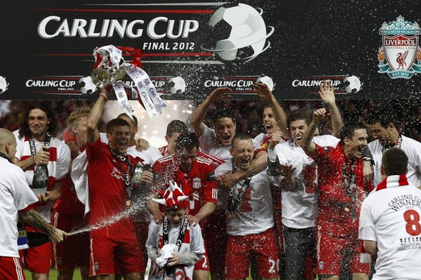Liverpool's players celebrate after winning the Carling Cup over Cardiff City in at Wembley