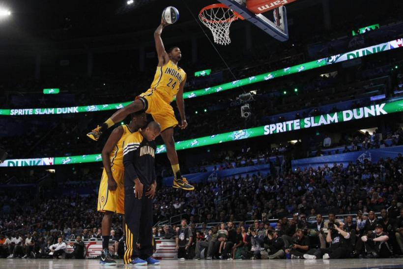 Pacers Paul George jumps over teammates