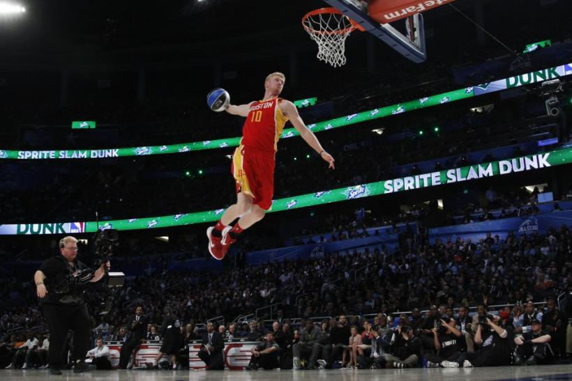 Rockets' Budinger competes in the slam dunk contest during the NBA All-Star weekend in Orlando
