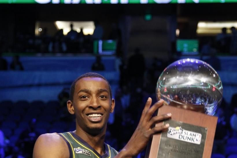 Utah Jazz Evans holds the trophy after winning the slam dunk contest during the NBA All-Star weekend in Orlando