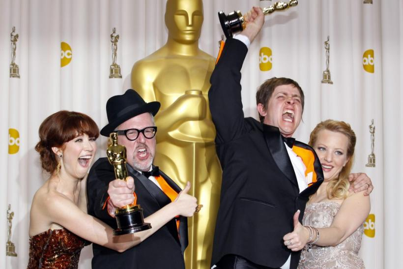 William Joyce and Brandon Oldenburg, winners of Best Animated Short Film, celebrate with their awards backstage during the 84th Academy Awards in Hollywood