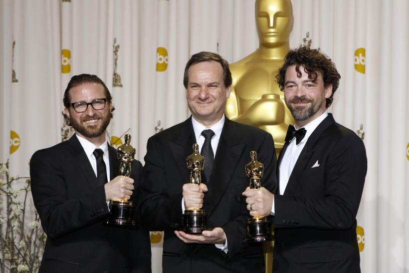"Alex Henning, Rob Legato and Ben Grossmann, winners of the Visual Effects award for the film ""Hugo"", pose with their Oscars during the 84th Academy Awards in Hollywood"
