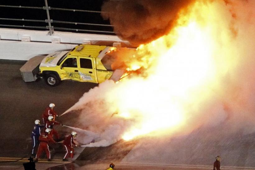 A jet dryer truck burns on the track at the Daytona 500 after Juan Pablo Montoya smashed into it.