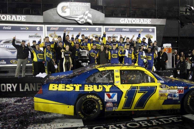 Kenseth celebrates after winning the rain delayed NASCAR Sprint Cup Series Daytona 500 at the Daytona International Speedway in Daytona Beach