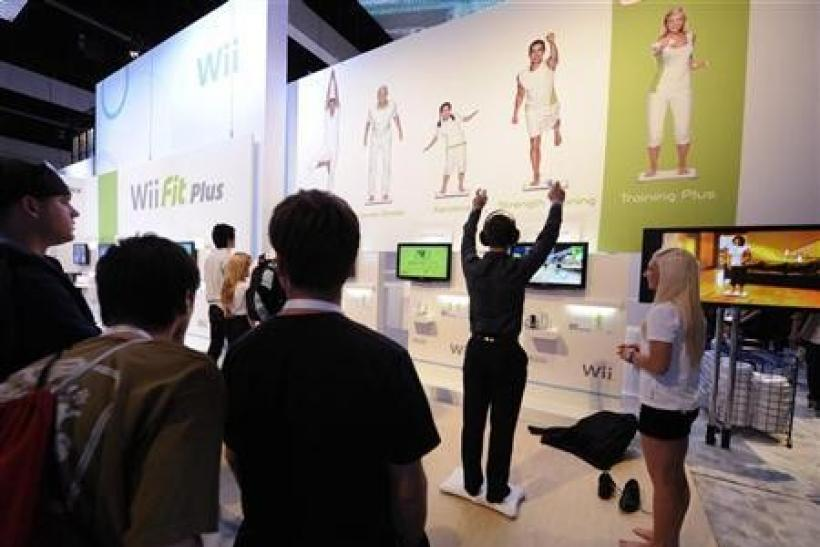 Attendees play Wii Fit Plus at the E3 Electronic Entertainment Expo in Los Angeles June 2, 2009.