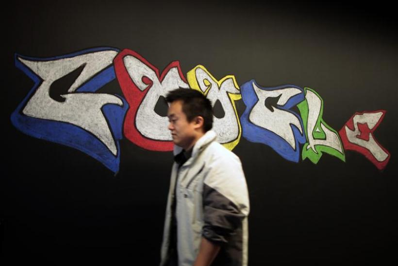 A man walks past a Google logo drawn with chalk on a wall at the Google campus near Venice Beach, in Los Angeles