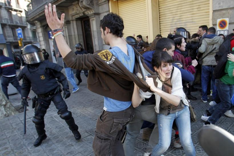Police charge protesters during anti-austerity demonstrations in Barcelona