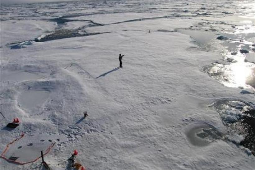 A member of a team of Cambridge scientists trying to find out why Arctic sea ice is melting so fast, walks on some drift ice 500 miles (800 km) from the North Pole September 3, 2011.