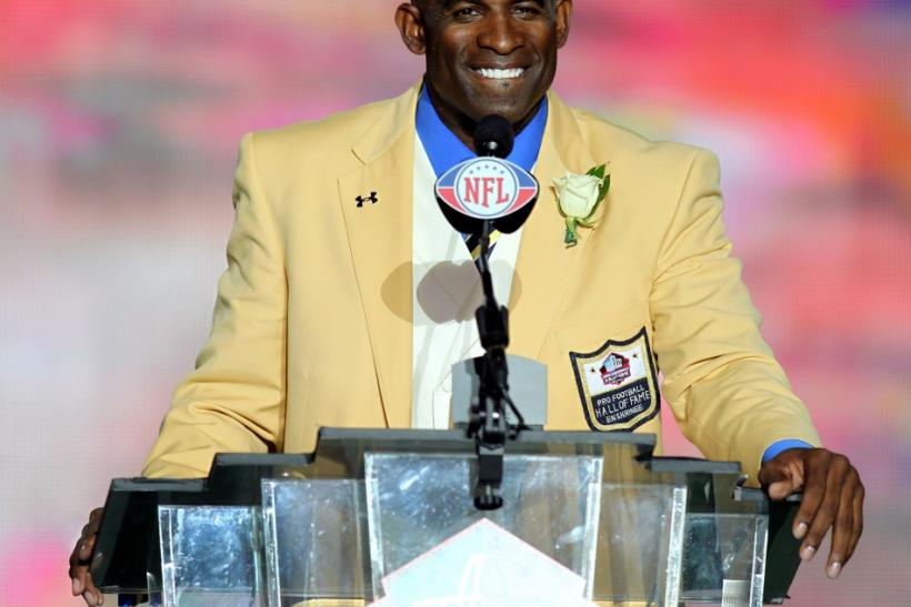 Former Dallas Cowboy Deion Sanders delivers his acceptance speech during his induction into the NFL Pro Football Hall of Fame in Canton