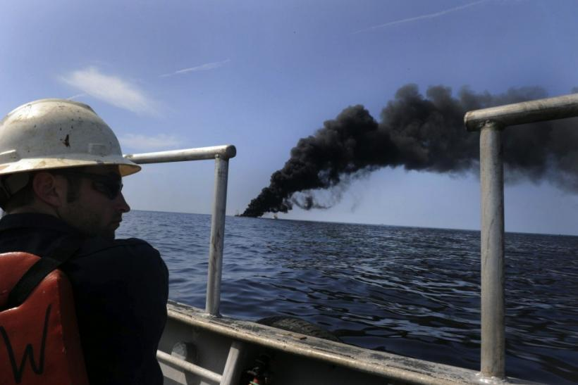 Adam Shaw, a Louisiana oilfield diver assigned to the Premier Explorer, performs a surveillance mission during a controlled fire of the oil-covered waters in the Gulf of Mexico May 7, 2010. The U.S. Coast Guard working in partnership with BP PLC, local re