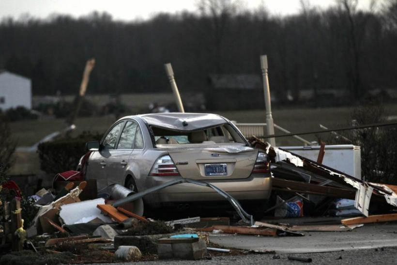 Residents work to clear storm damage after three tornadoes moved through the area in Chelsea, Indiana March 2, 2012.