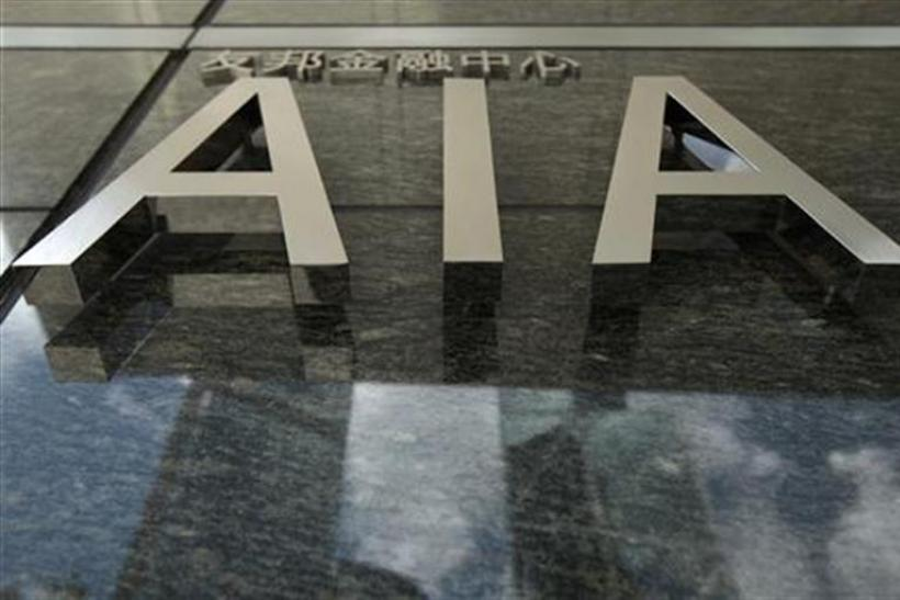 The logo of the AIA tower is seen at its entrance in Hong Kong